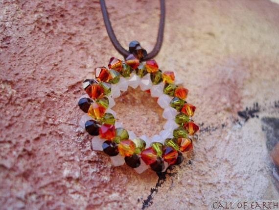 Tribal circle. Orange green swarovski crystal pendant  necklace Beadwork jewelry