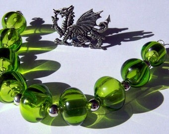 "Hollow Glass beads ""9"" in grass green made by Ray Skene SRA FH"