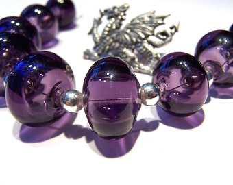 "Hollow Glass beads ""9"" in medium purple made by Ray Skene SRA FH"