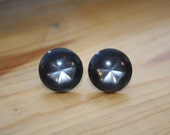 Vintage Black Stud Earrings with Glowing Starburst