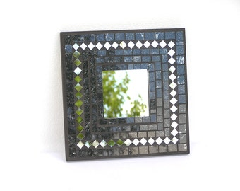 Wall mirror black angular glass mosaic decorated with pieces of mirror