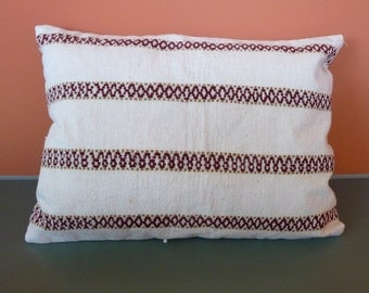 Handwoven, naturally dyed, Indonesian ceremonial textile made into a pillow cover