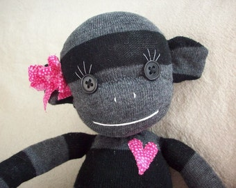 A Sock Monkey in Black and Grey Stripes- Georgia