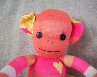 Sock monkey doll in peach and yellow stripes, Cora