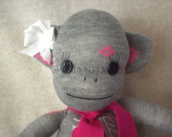 Sock monkey in grey with snowflakes, January