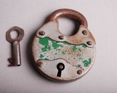 Vintage iron padlock with key.