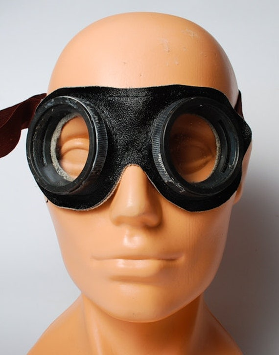 Vintage safety glasses, industrial goggles.