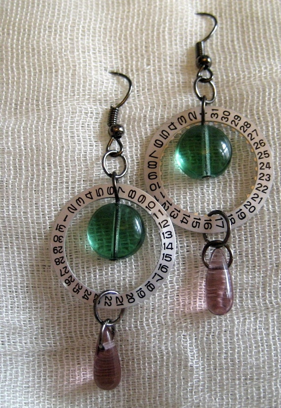 Feminine second dial earrings