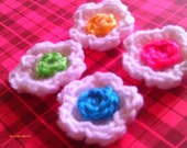 Set of Four Crochet Flowers - Yellow, Pink, Blue, and Green on White Flower