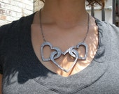 Linked Heart Necklace made from faux leather wallpaper