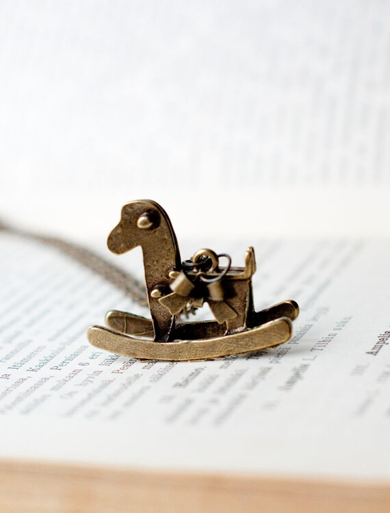 The rocking horse necklace - necklace with a rockinghorse and a bow. Antiqued bronze.