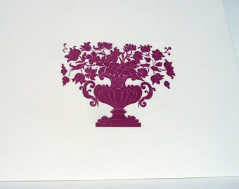 Purple urn with flowers