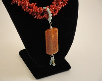 Multi-strand Coral Necklace and Pendant.