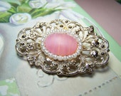 Belle - Frosty 1970's brooch. Pearls and filigree details. Gold and white. Pink stone.