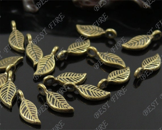 special offer 12pcs of  Antique brass charming leaf drop pendant,metal finding,drop leaf  bead 6x16mm