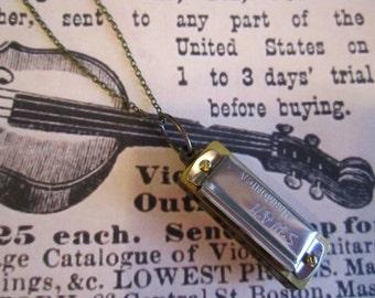 Peddler Working Harmonica Necklace