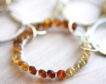 Modern citrine circles in gold