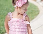 baby pink ruffle romper with matching flower headband