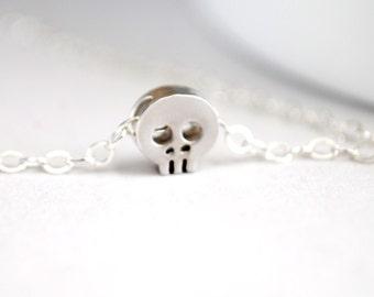 Silver Tiny Skull Necklace. Miniature Skull Necklace