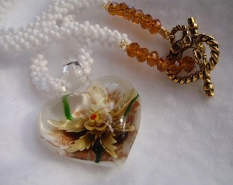 Gold Glass and Flower Heart Pendant on a White Handmade Seed Bead Chain