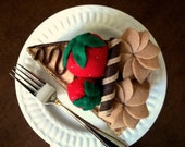 large slice of felt cake - chocolate and strawberries