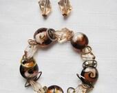 Floating Rings Stretch Bracelet & Earrings Set,  Amber Lampwork Beads, Champagne Bicone Crystal, Locket Charm