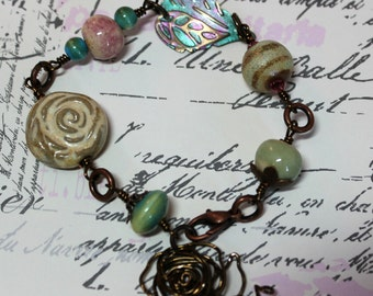 Spring Rose, Beige, Teal, and Brown Ceramic beads with copper and brass wire bracelet - inked metal leaf