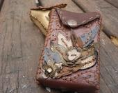 brown leather cigarette case , digital camera case or card case