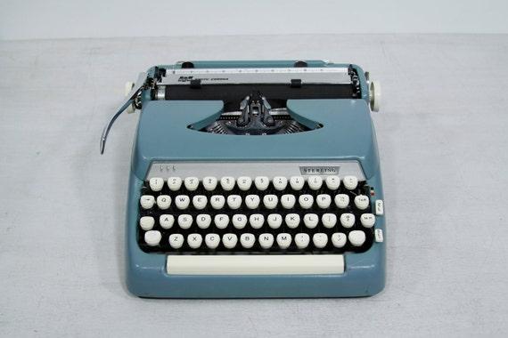 Blue Sterling Smith Corona Typewriter