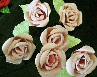 Six light pink paper flower long stemmed roses bouquet with green leaves