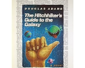 The Hitchhikers Guide to the Galaxy Book Cover on a Vintage Dictionary Page