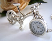 the bicycle pocket watch (necklace).