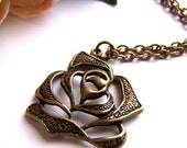 the bronze rose necklace.