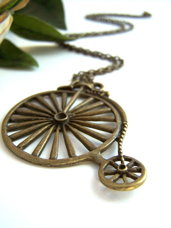 the bronze penny farthing necklace.
