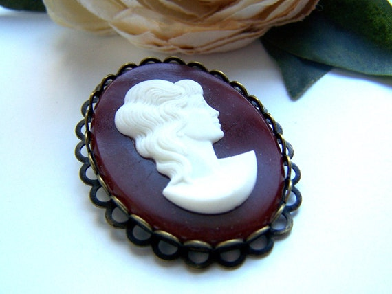 the maroon lady cameo brooch.