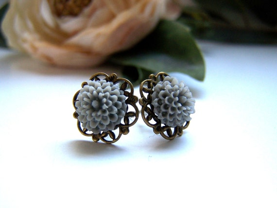 the petite gray pom stud earrings.