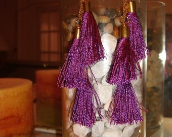 Drop earrings with purple tassels