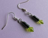 Earrings hematite greenish yellow glass