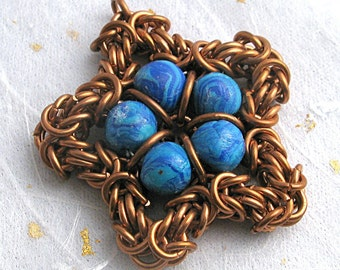 Copper chainmail and polymer clay star pendant