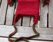 Red and green hat with tassels