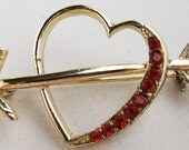Vintage jewelry brooch in  red rhinestone heart brooch with arrow 70s