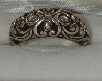 Vintage 925 pierced silver ring with box size six half with a stylized heart cross motif ring