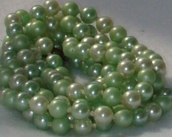 Vintage jewelry necklace in shades of green simulated pearl necklace with origianl clasp on 52 inch Rope necklace Sale  half price