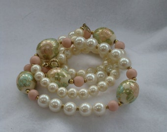 Vintage  jewelry necklace in simulated ivory pearls and cloisonne pink green outline in gold tone beaded necklace