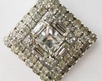 Vintage jewelry brooch in clear rhinestone brooch hand set in high polish silver tone 60s