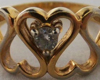 Vintage Korea gold tone ring with clear quartz stone and heart motif size 8 half ring