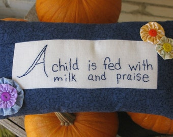 Sale - A Child is fed with Milk and Praise - Hand Embroidered Pillow