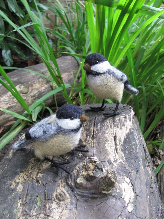A pair of needle felted chickadees