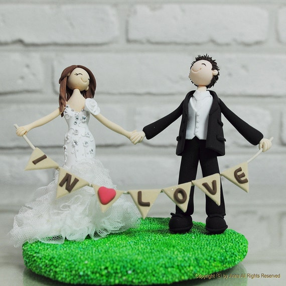 Cute couple holding banner wedding cake topper gift - In Love