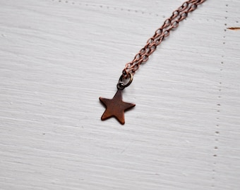 tiny star -necklace (bronze star charm and vintage bronze chain minimal discreet neckpiece)